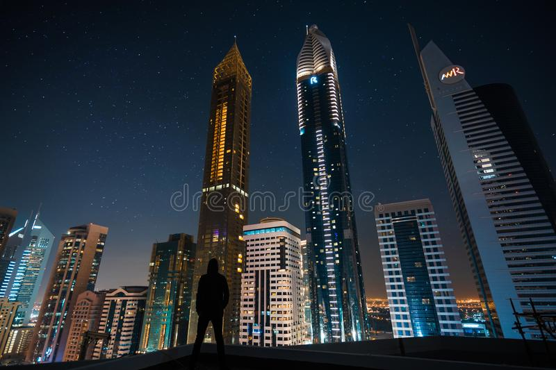 Man Standing in Assorted Building String Light during Night Time royalty free stock images