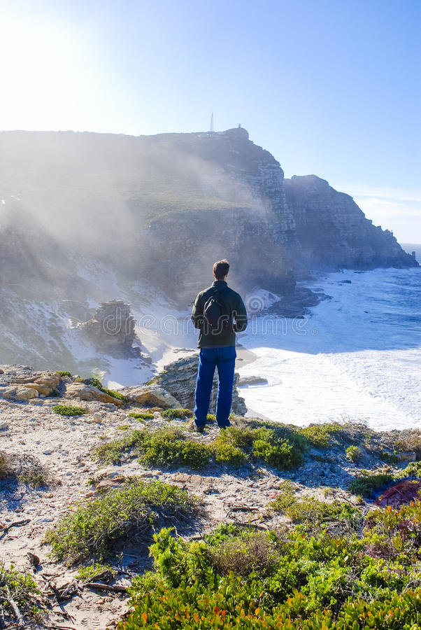 Man standing on the Beach at Cape point in the tip of south Africa royalty free stock photo