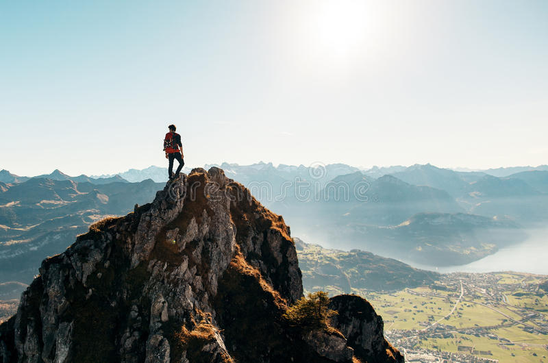 Man Standing On Brown Rocking Mountain Under Blue Sky And Yellow Sunlight Free Public Domain Cc0 Image