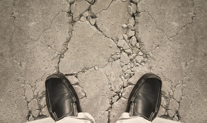 A man standing on crack ground. For risk concept stock images