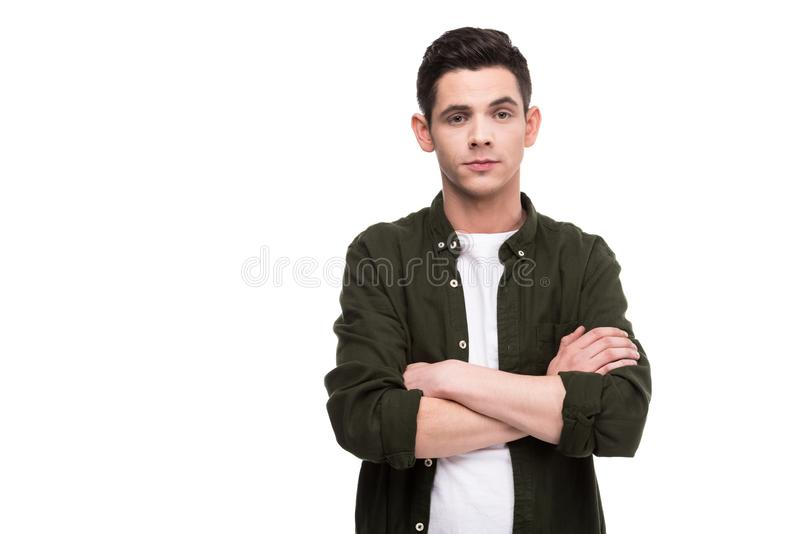 man standing with crossed arms royalty free stock photo