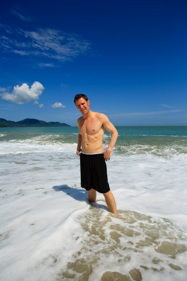Man standing on exotic beach royalty free stock images