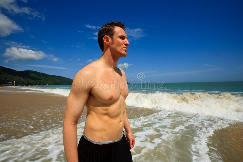 Man standing on exotic beach stock photo