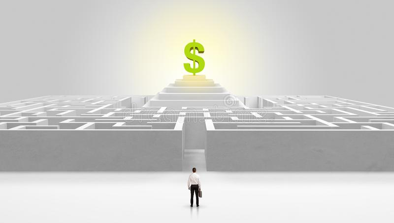 Man standing outside of a maze with profit concept on the middle stock image