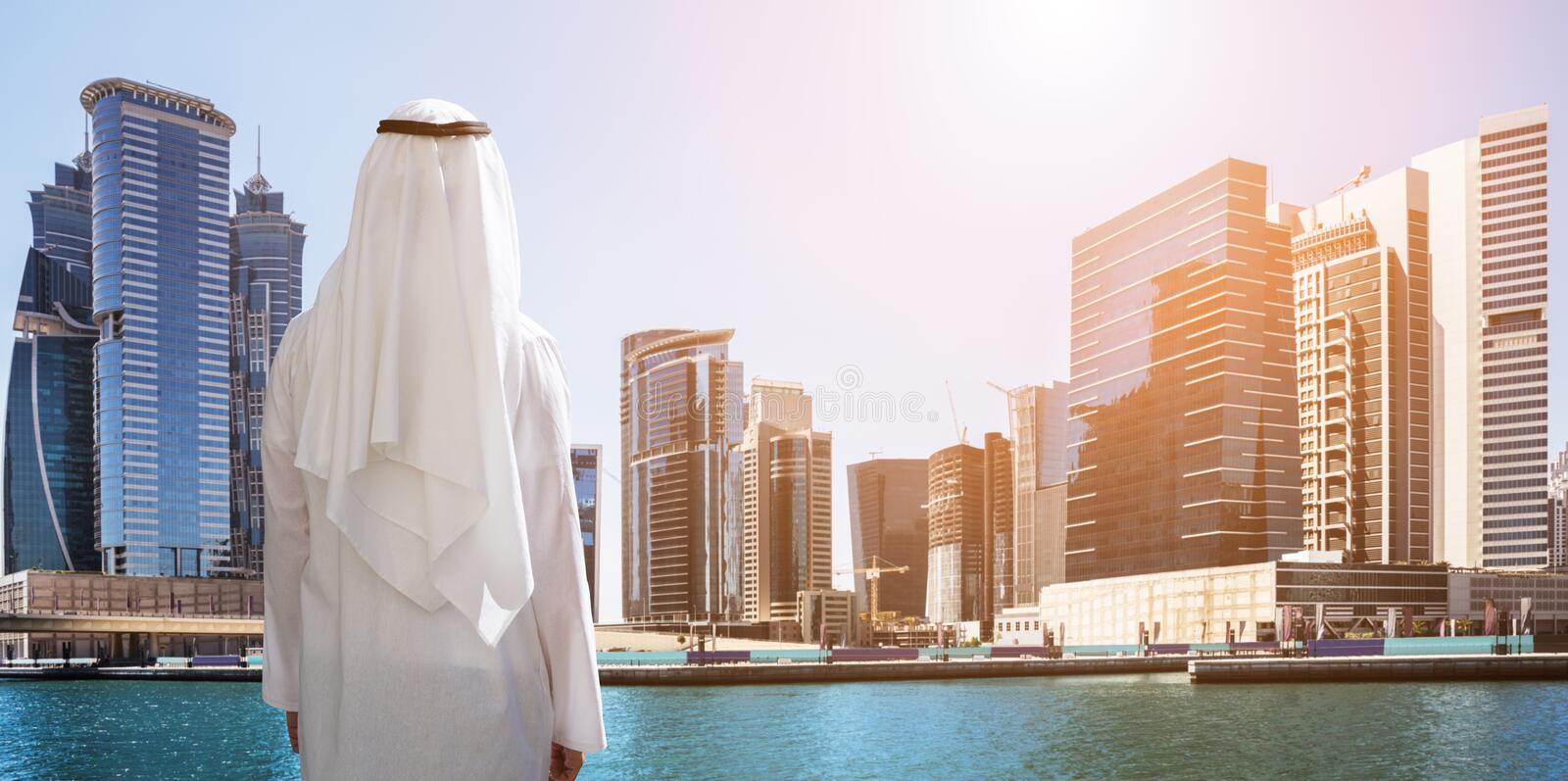 Man Standing In Front Of Dubai Business Bay stock photography