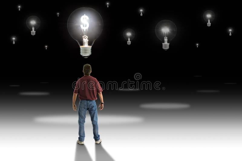 Man standing in front of light bulb with glowing money symbol representing great money making idea royalty free stock photography