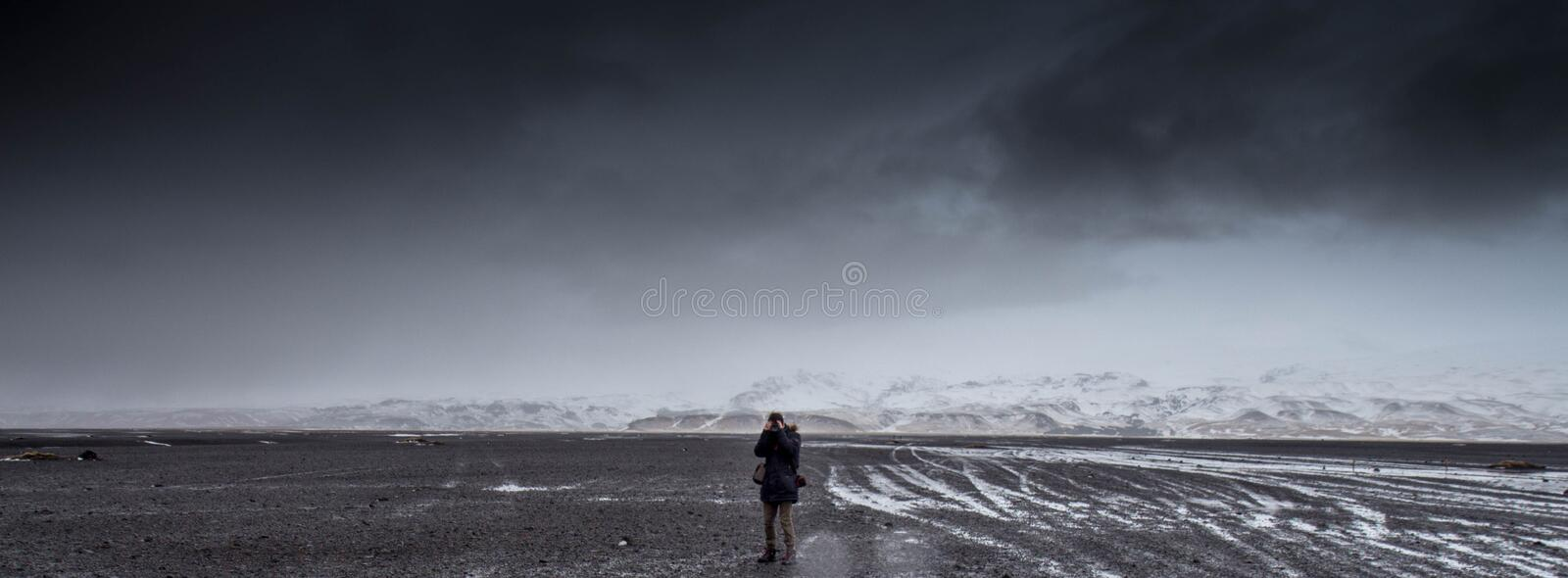 Man Standing On Gray Dessert Under Gray Cloudy Sky During Daytime Free Public Domain Cc0 Image