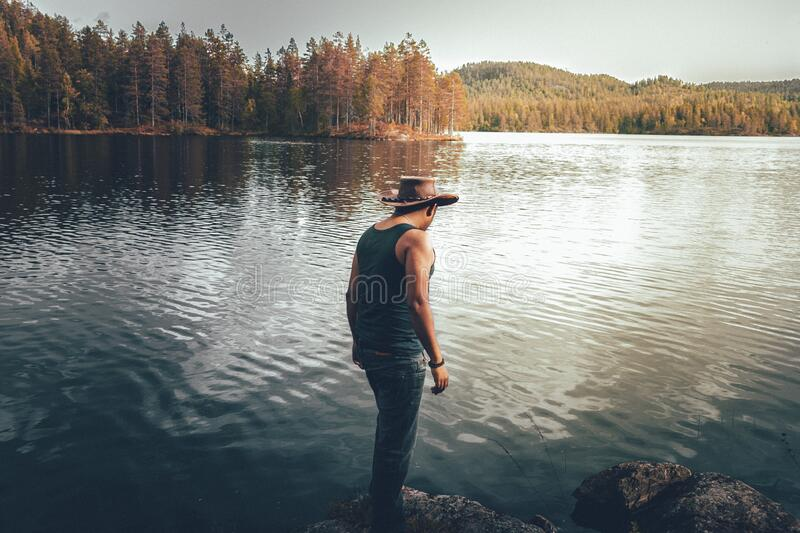 Man standing on lakefront royalty free stock image