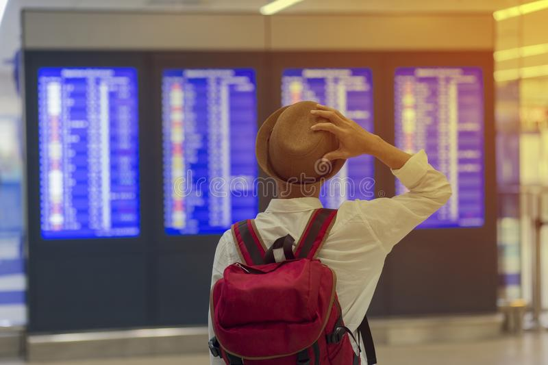Man standing and looking flight board in airport royalty free stock photography