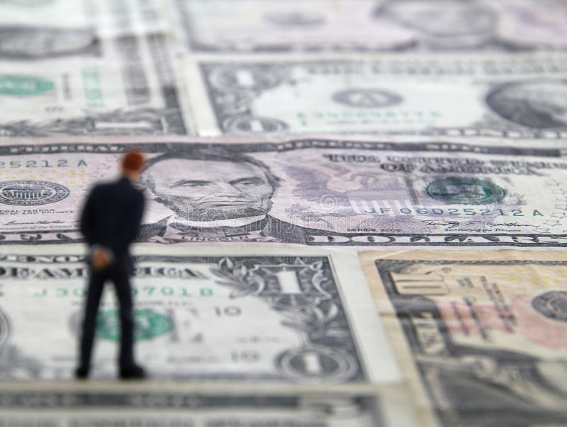 Man Standing On A Money Floor Stock Photography