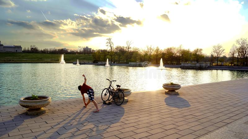 Man Standing Near Bicycle and Body Water royalty free stock photos