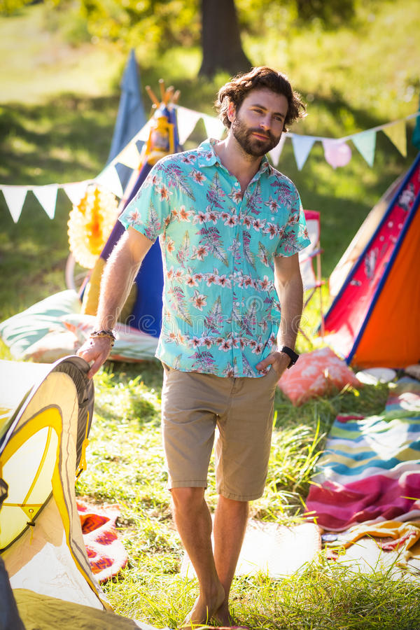 Man standing near campsite. Portrait of man standing near campsite in park on a sunny day royalty free stock photography