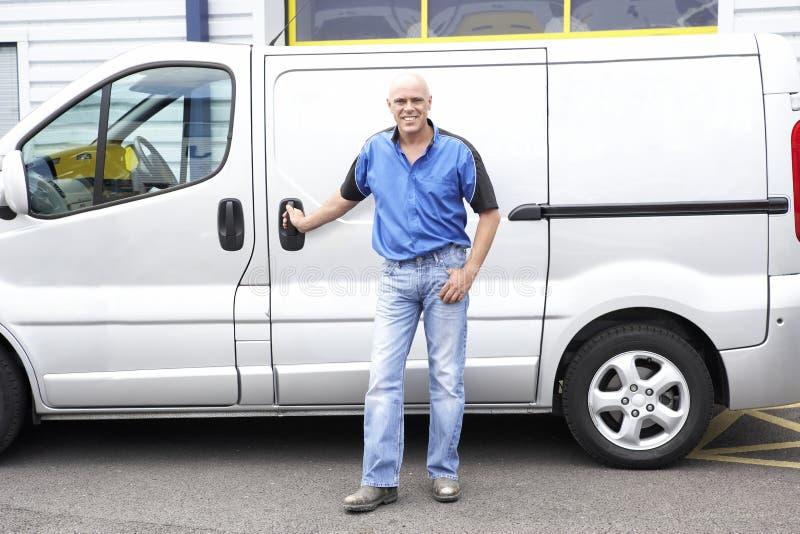 Man standing next to van royalty free stock image