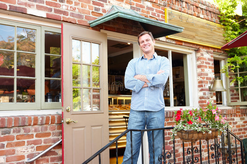Download Man Standing Outside Bakery Stock Photo - Image: 20892052