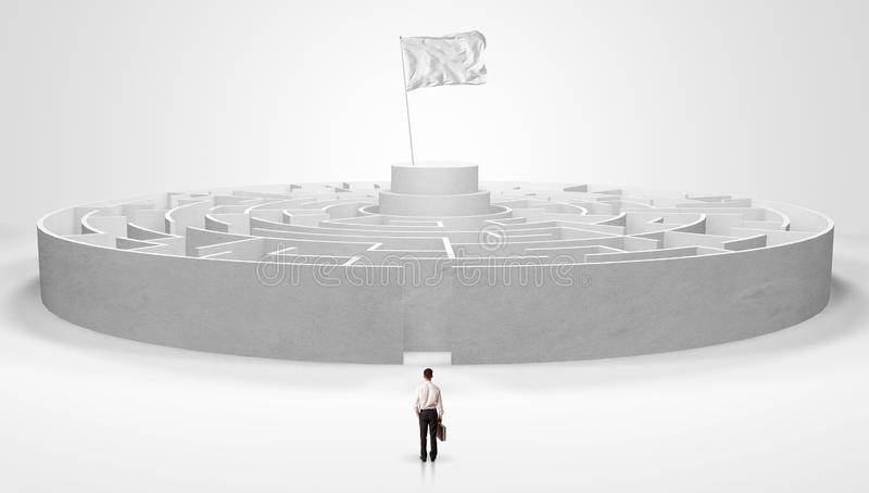 Man standing outside of a maze royalty free stock image