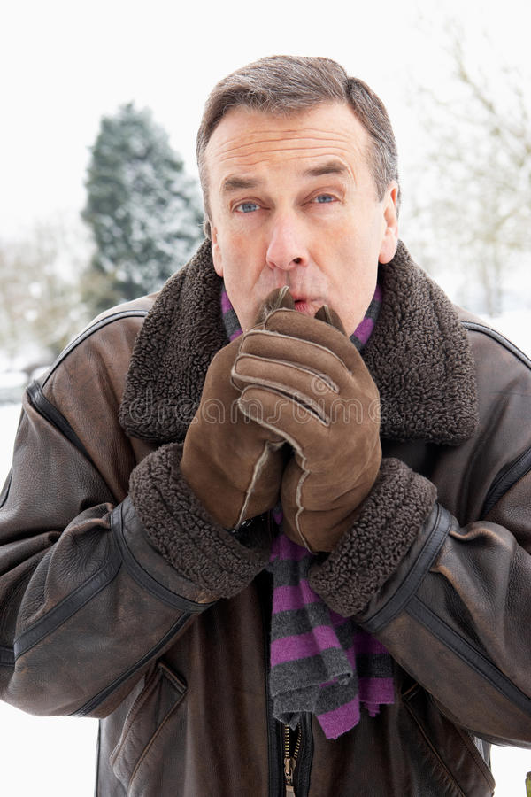 Download Man Standing Outside In Snow Warming Hands Stock Photo - Image: 12988448