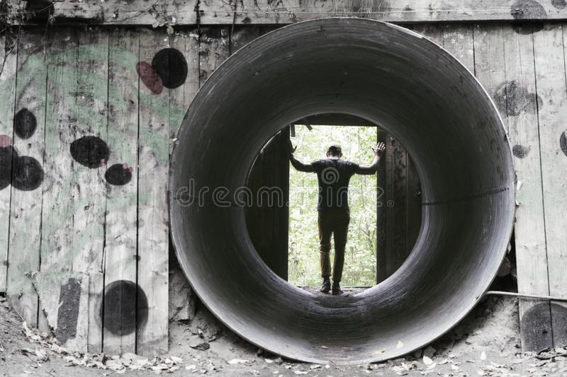 Man standing in the remains of Nobel`s blasting bunkers. stock photo