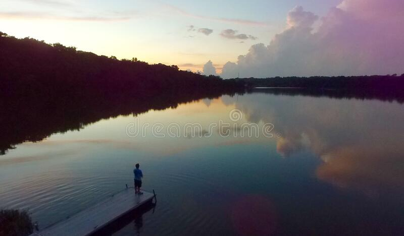 Man Standing On River Dock During Sunset Free Public Domain Cc0 Image
