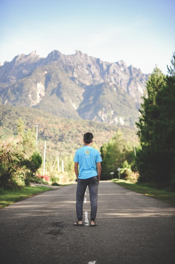Man Standing on Road stock image