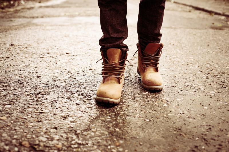 Man standing on road. Close up image. royalty free stock images