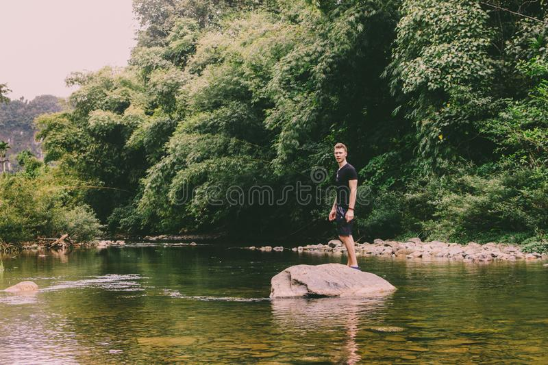 Man Standing On Rock royalty free stock photography