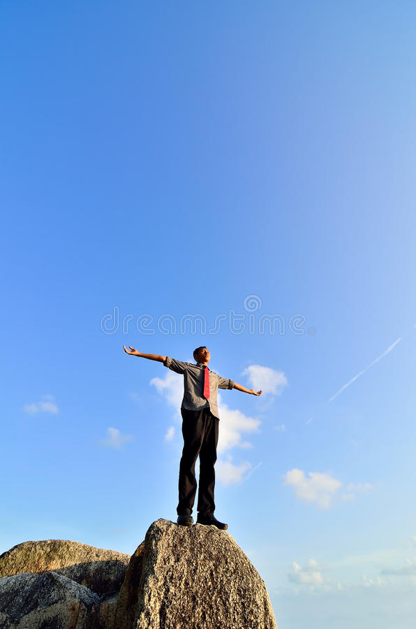 Download Man standing on the rock stock image. Image of happy - 39511517