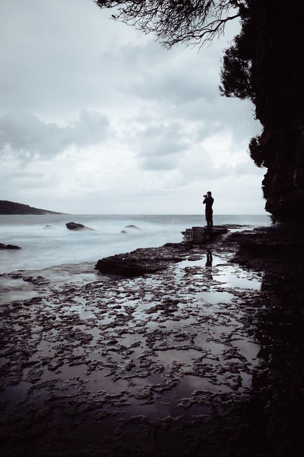 Man Standing on Rock Near Ocean royalty free stock photo