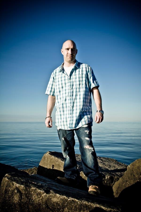 Man Standing on rocks royalty free stock photos
