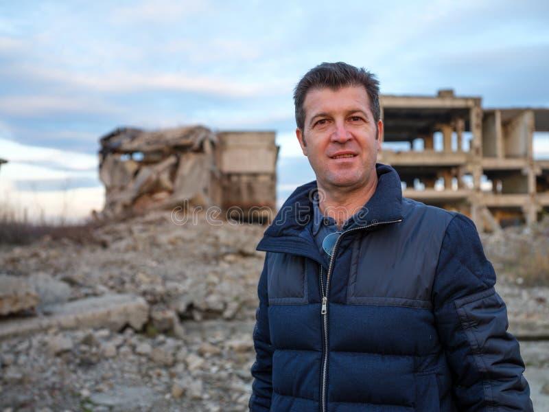 Man standing among ruins. Man standing among industrial ruins stock photo