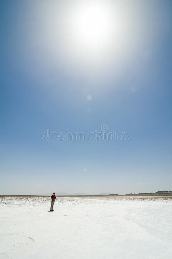 Man standing in salt dried-up lake Haj Aligholi near Damghan in Iran stock images