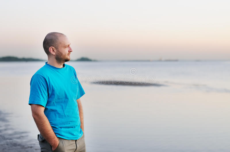Man standing by the sea stock photos