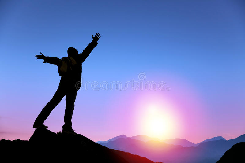 Man standing on the top of mountain royalty free stock photos