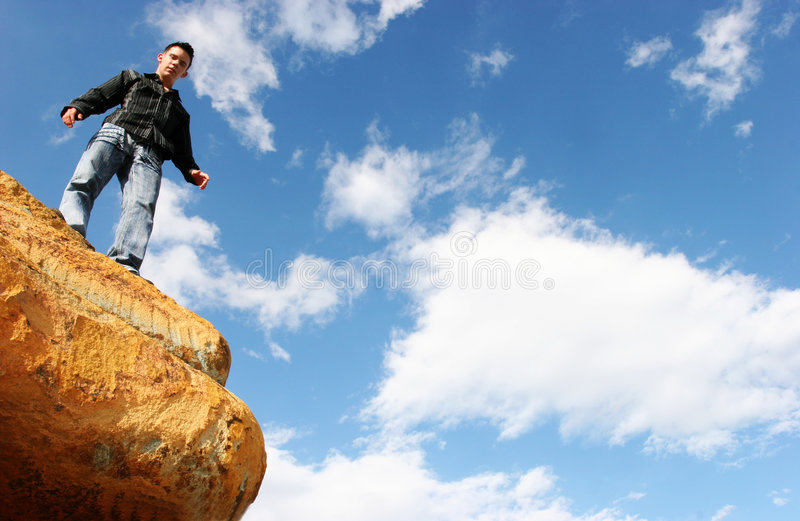 Man standing on top of the world royalty free stock image