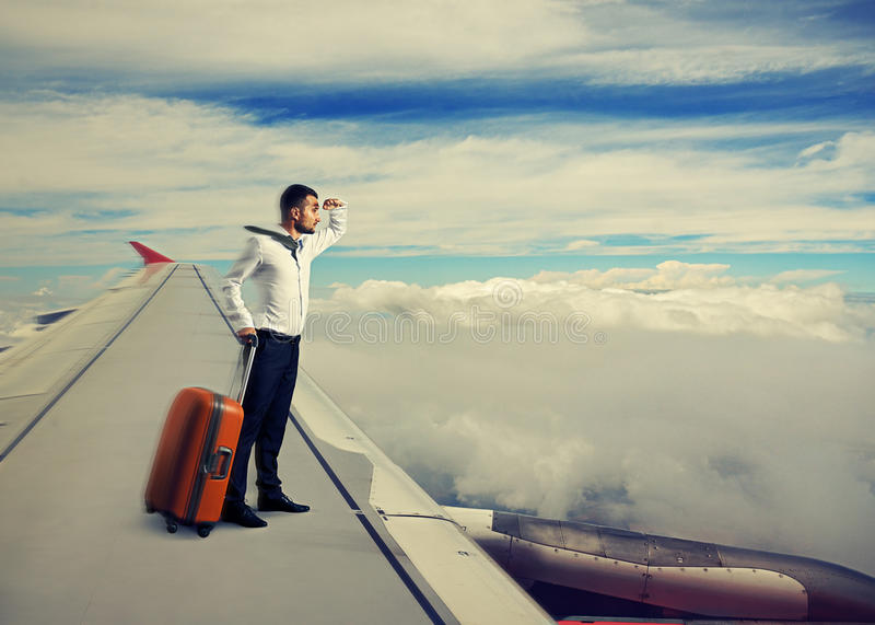 Download Man standing on the wing stock photo. Image of arrival - 33016692