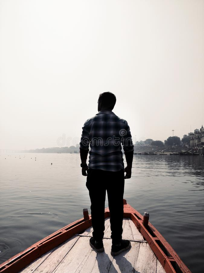 Man Standing On Wooden Boat royalty free stock image
