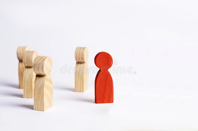 A red man stands in the crowd and looks the other way on a white background. Concept meeting rally. Another view and point of view royalty free stock image