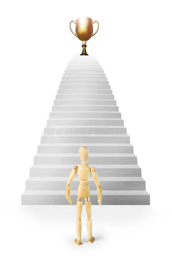 Man stands in front of stairs ascending up to the prize. Abstract image with a wooden puppet royalty free stock images