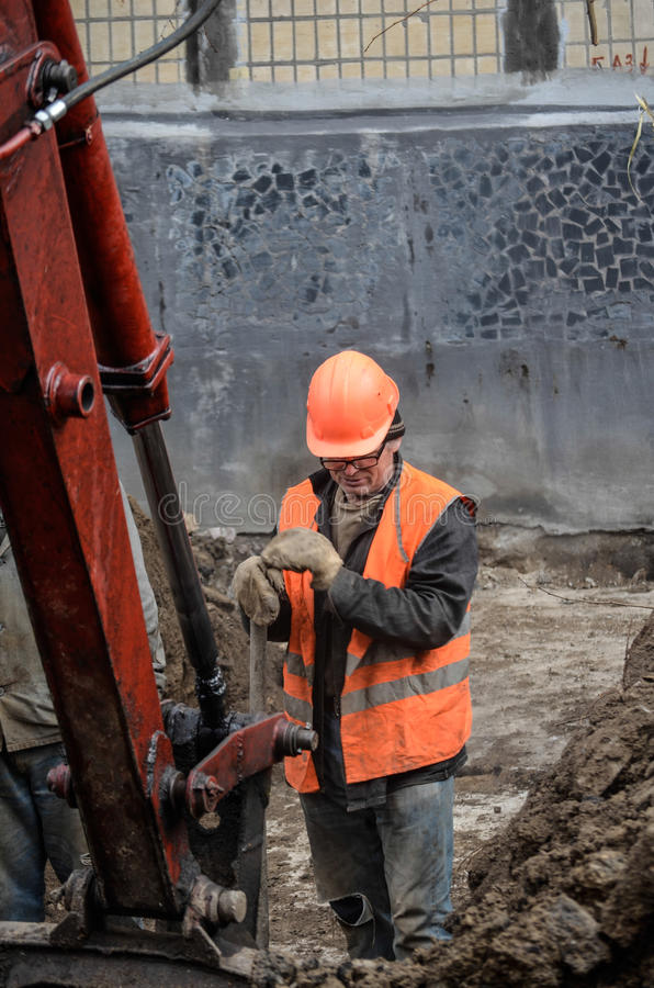 A man stands in the pit with a shovel royalty free stock photography