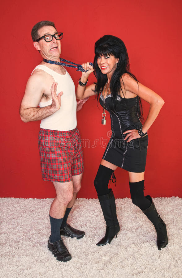 Download Man Stands Terrified Of Dominatrix Woman Stock Image - Image of leather, isolated: 21024043