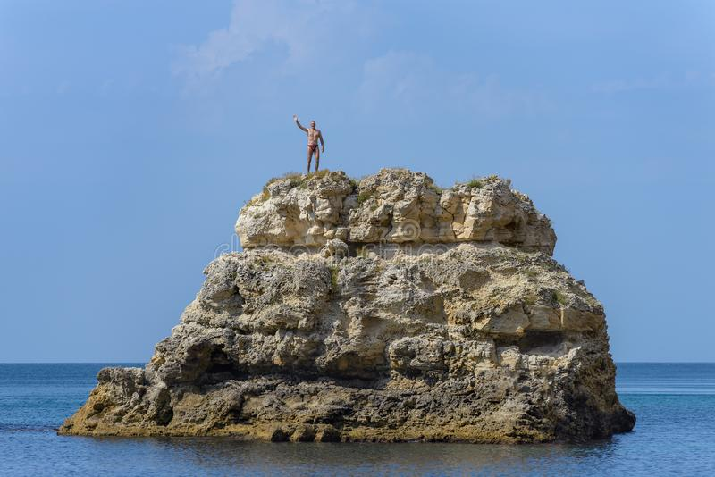 A man stands on top of a cliff royalty free stock images