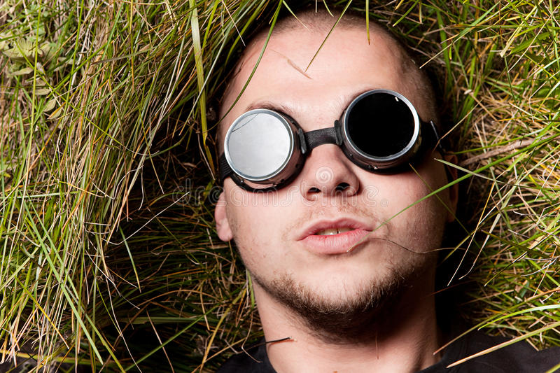 Man stare to you through glasses, think about it stock images