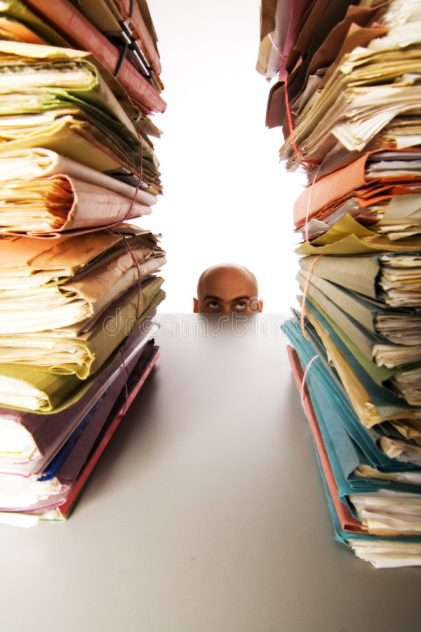 Man stares at files stock images