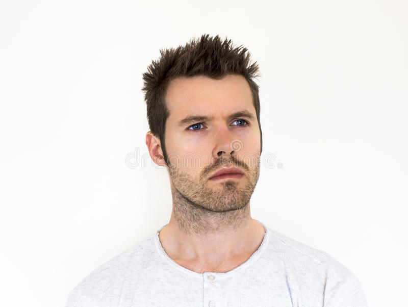 Man staring into the distance. A man staring into the distance with a white cropped background royalty free stock photos