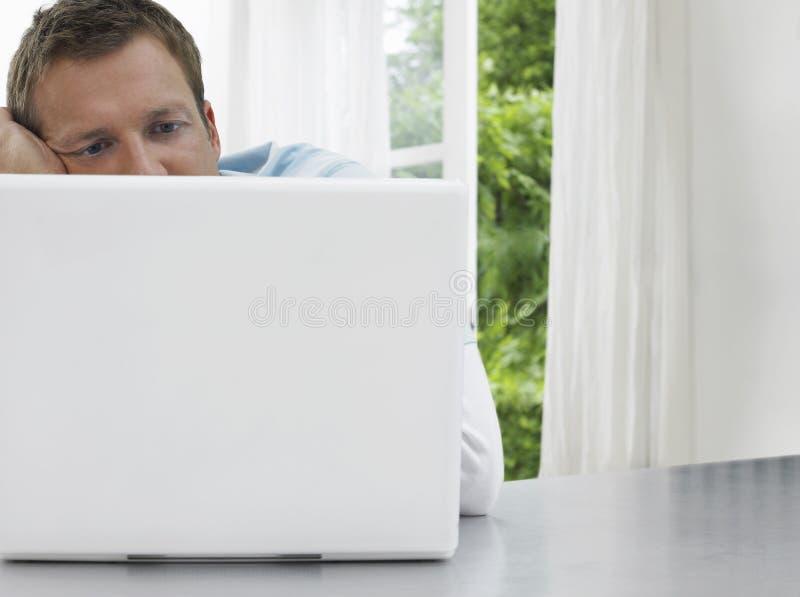 Man Staring At Laptop Royalty Free Stock Photography
