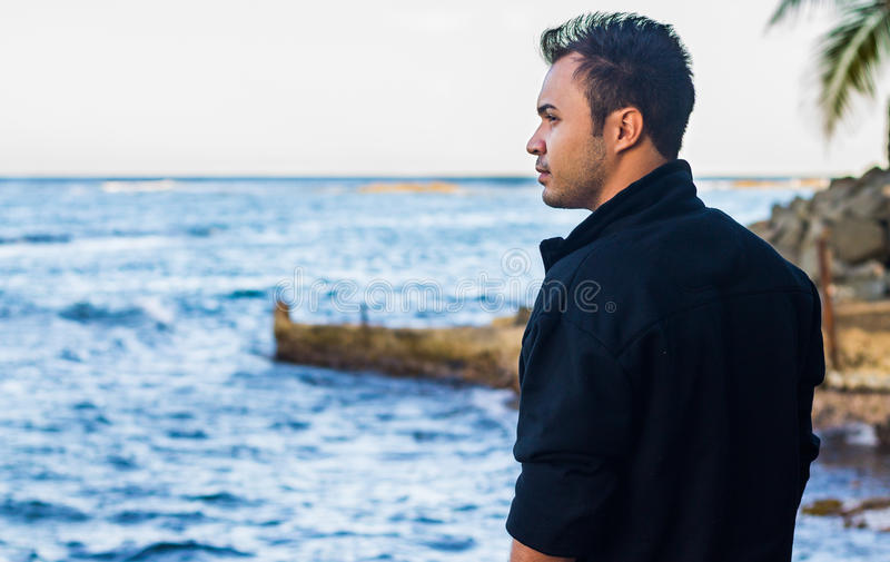Man staring at the sea stock images