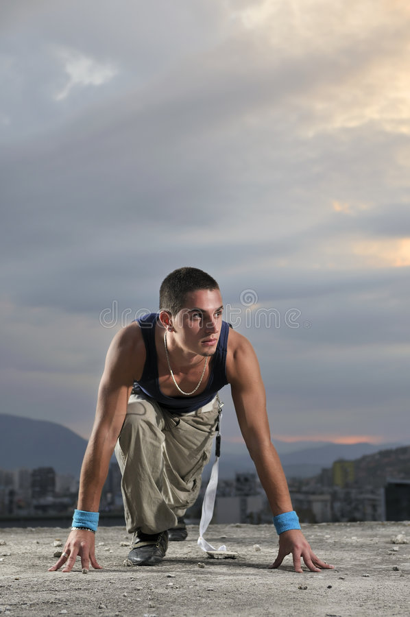 Man on the start position ready to run. Young man ready for run on the start position ready to run royalty free stock photos