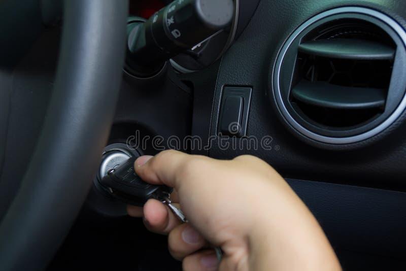 A man starting the car. Man starting the car with key royalty free stock photo