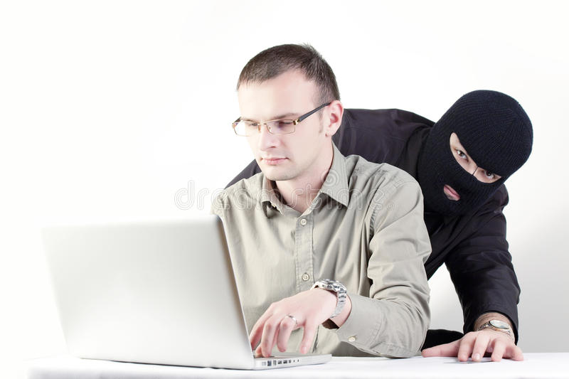 Man stealing card from a shopping man stock photos