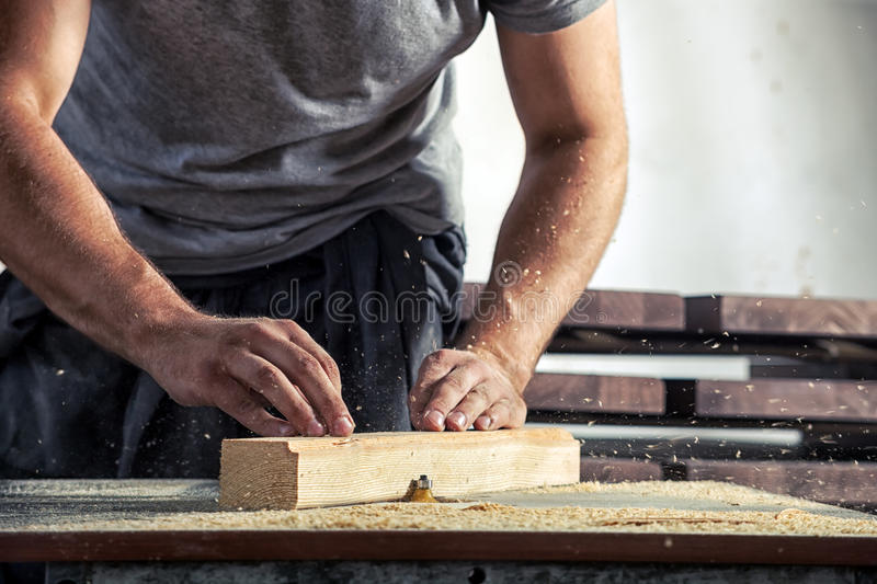 Man steals a wooden with a milling machine stock photo