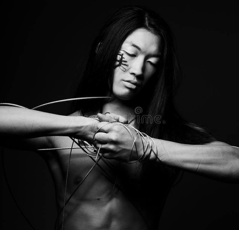 Man with steel wire. Over black background stock photos